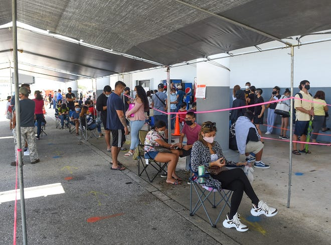Residents line up for driver's licenses at the Guam Department of Revenue and Taxation in Barrigada, Aug. 1, 2020.