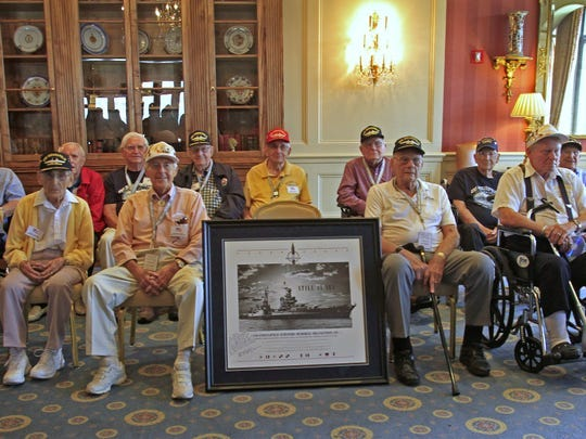 Fourteen of the living survivors of the USS Indianapolis pose for a photo at the Columbia Club in 2013.