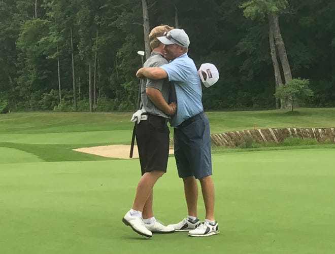 Brent Hofman (right) congratulates his son, Nic, after Saturday's semifinals at the Men's City Championship. Nic defeated Brent, 3&2.