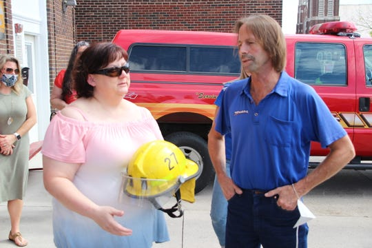 Stephanie Syvertsen, left, widow of former Marion Menard's store manager Gary Syvertsen, talks with Doug Foght, a Menard's employee and close friend of her husband, on Friday, July 31, 2020, at the Marion Fire Department. Members of the Syvertsen family and Gary Syvertsen's Menard's co-workers donated 104 box fans to the fire department for distribution to community residents in need.