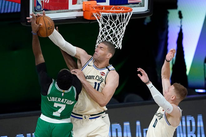 Bucks center  Brook Lopez blocks a shot by the Celtics' Jaylen Brown on Friday night  in Lake Buena Vista, Fla.