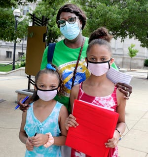 Jerrilyn Johnson of Racine and granddaughters Dalani Finley, 7, and Dailynn Finley, 10, are masked while out and about Saturday, Aug. 1, 2020, the first day of Gov. Tony Evers' mandate requiring them to be worn indoors. As a health worker, Johnson said she believes in wearing masks to control the spread of the coronavirus.