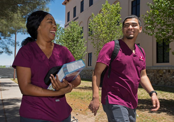 Sharneece Pratt and Stephen Montoya, who earned bachelor's degrees in nursing in 2019 from New Mexico State University, walk to a class in the NMSU Health and Social Services Building. NMSU's College of Health and Social Services will use a $500,000 donation from Blue Cross and Blue Shield of New Mexico to create a new faculty position in the School of Nursing and fund 40 scholarships for students in bachelor-level nursing and social work programs.