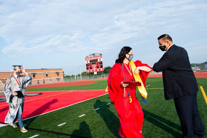 Masks and elbows, as seen here at Bermudian Springs High School's summer graduation ceremony, will be more the norm as students head back to school this fall. Districts in the area are planning everything from in-person learning, to virtual to a hybrid model.