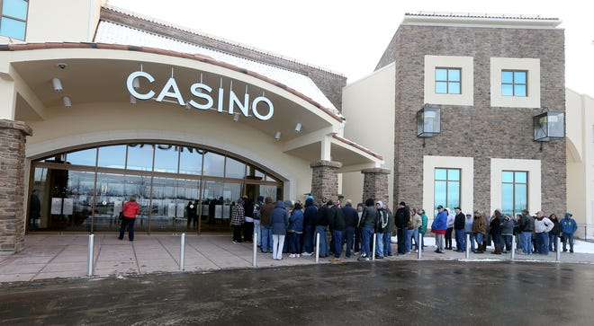 People wait outside del Lago Casino for its grand opening in Tyre in 2017. The casino has been closed since mid-March.