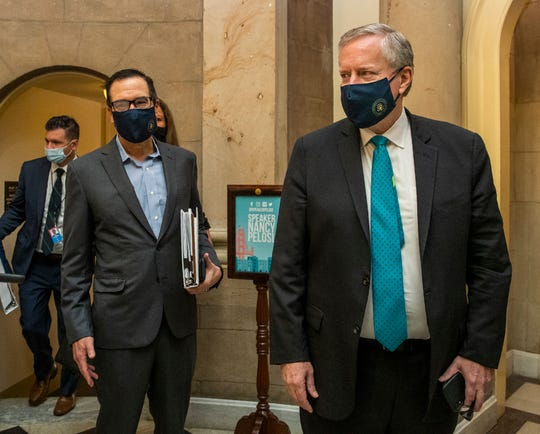 White House chief of staff Mark Meadows, right, and Treasury Secretary Steven Mnuchin, arrive at the office of House Speaker Nancy Pelosi at the Capitol to resume talks on a COVID-19 relief bill on Saturday.