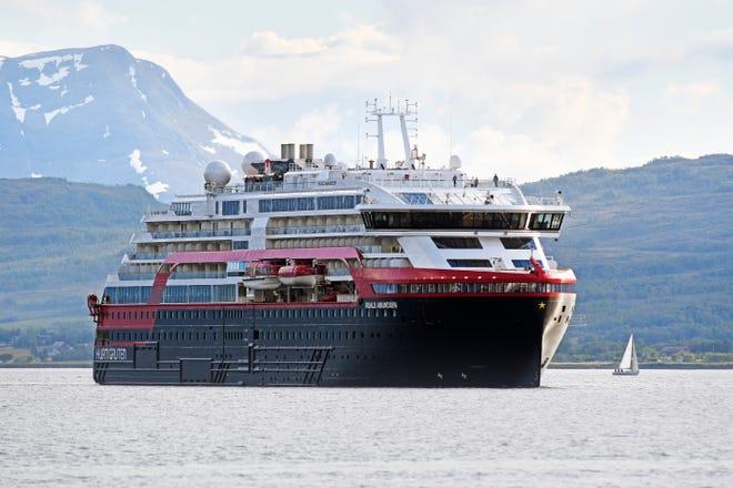 The new hybrid-powered expedition ship MS Roald Amundsen cruise ship arrives in Tromsoe, northern Norway, Wednesday July 3, 2019.  The MS Roald Amundsen is the first of the new hybrid-powered expedition ships in Hurtigruten's fleet.