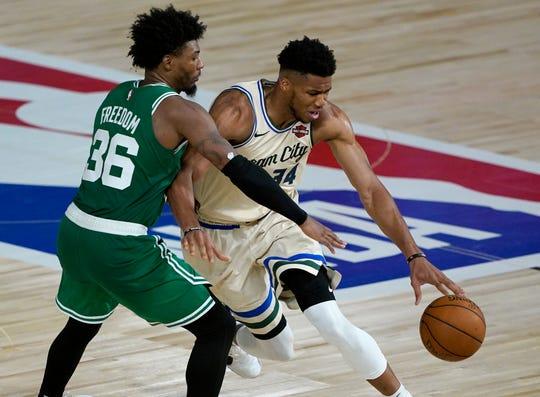 Celtics defender Marcus Smart makes life difficult for Bucks star Giannis Antetokounmpo.