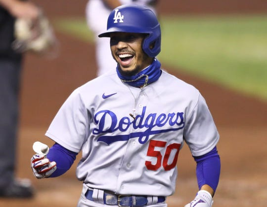 Mookie Betts celebrates his first home run as a member of the Dodgers.