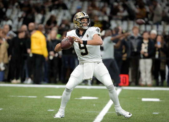 Drew Brees warms up before the NFC wild card game against the Minnesota Vikings on Jan. 5, 2020.