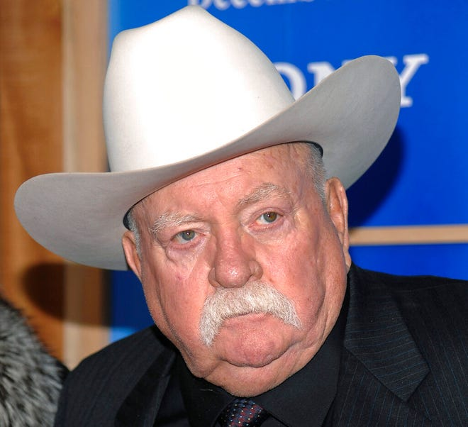 In this Monday, Dec. 14, 2009 file photo, Actor Wilford Brimley attends the premiere of 'Did You Hear About The Morgans' at the Ziegfeld Theater in New York.  Brimley's manager Lynda Bensky said the actor died Saturday morning, Aug. 1, 2020 in a Utah hospital. (AP Photo/Evan Agostini, File)