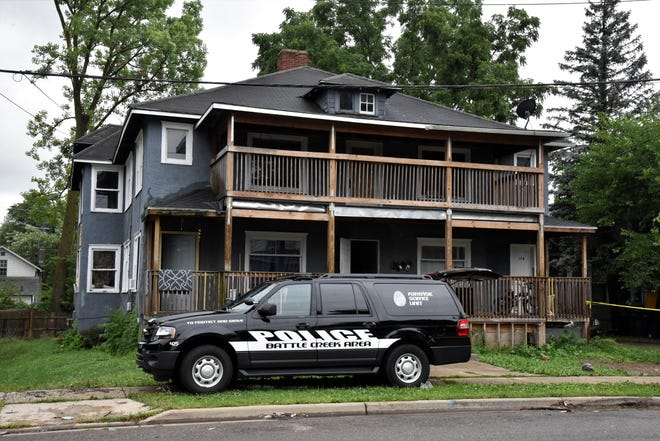 A Battle Creek Police Department Forensic Scene Unit at 176 Cherry St. in Battle Creek on Sunday, Aug. 2, 2020.