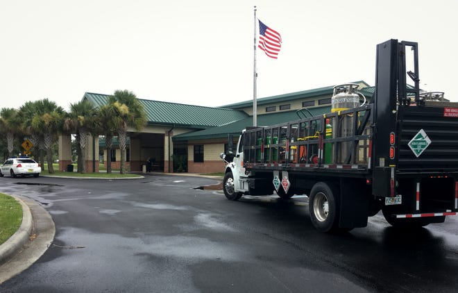 An oxygen truck arrives at Viera Regional Community Center, where a storm shelter briefly opened on Sunday.