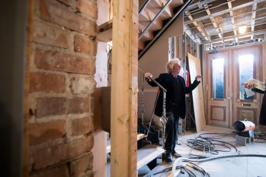 Developer Joel Landy gives a tour of the former rundown Scott Mansion while it was under restoration in  April 2018.