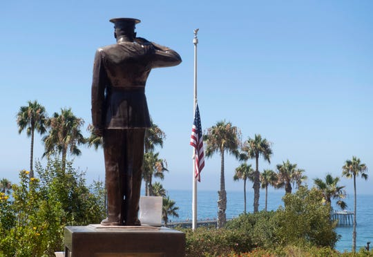 The U.S. flag was lowered to half-staff at Park Semper Fi in San Clemente, Calif., on Friday, July 31, 2020.