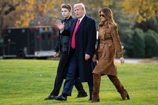 FILE - In this Tuesday, Nov. 26, 2019 file photo, President Donald Trump, first lady Melania Trump, and Barron Trump, walk to board Marine One on the South Lawn of the White House in Washington.