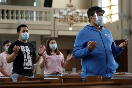 Parishioners wearing masks as a measure to prevent the spread of COVID19 pray during a Mass at the Our Lady of Consolation Parish on Sunday, Aug. 2, 2020, in Quezon city, Philippines.