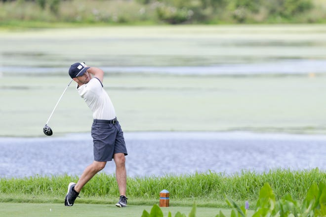 Austin Conroy swings on hole 14 during the final round of the 2020 Men's City Golf Championship, Sunday, Aug. 2, 2020 in West Lafayette.