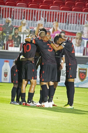 August 1, 2020; Tempe, AZ, USA; Phoenix Rising FC gather for a goal scored by forward Soloman Asante making the score 2-1 in the first half. Mandatory Credit: Justin Toumberlin/The Arizona Republic via USA TODAY NETWORK