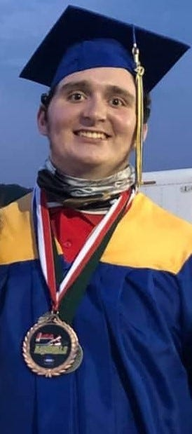 Patrick Maloney is shown wearing his powerlifting medals while graduating from Kennard-Dale High School recently.