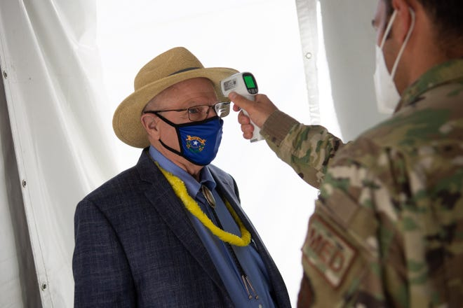 State Senator Joe Hardy has his temperature checked by a member of the Nevada National Guard before entering the Legislature on Saturday, Aug. 1, 2020 before the second day of the 32nd Special Session in Carson City.