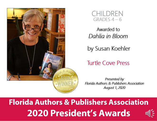Susan Koehler with her book, Dahlia in Bloom, and the award information from FAPA.