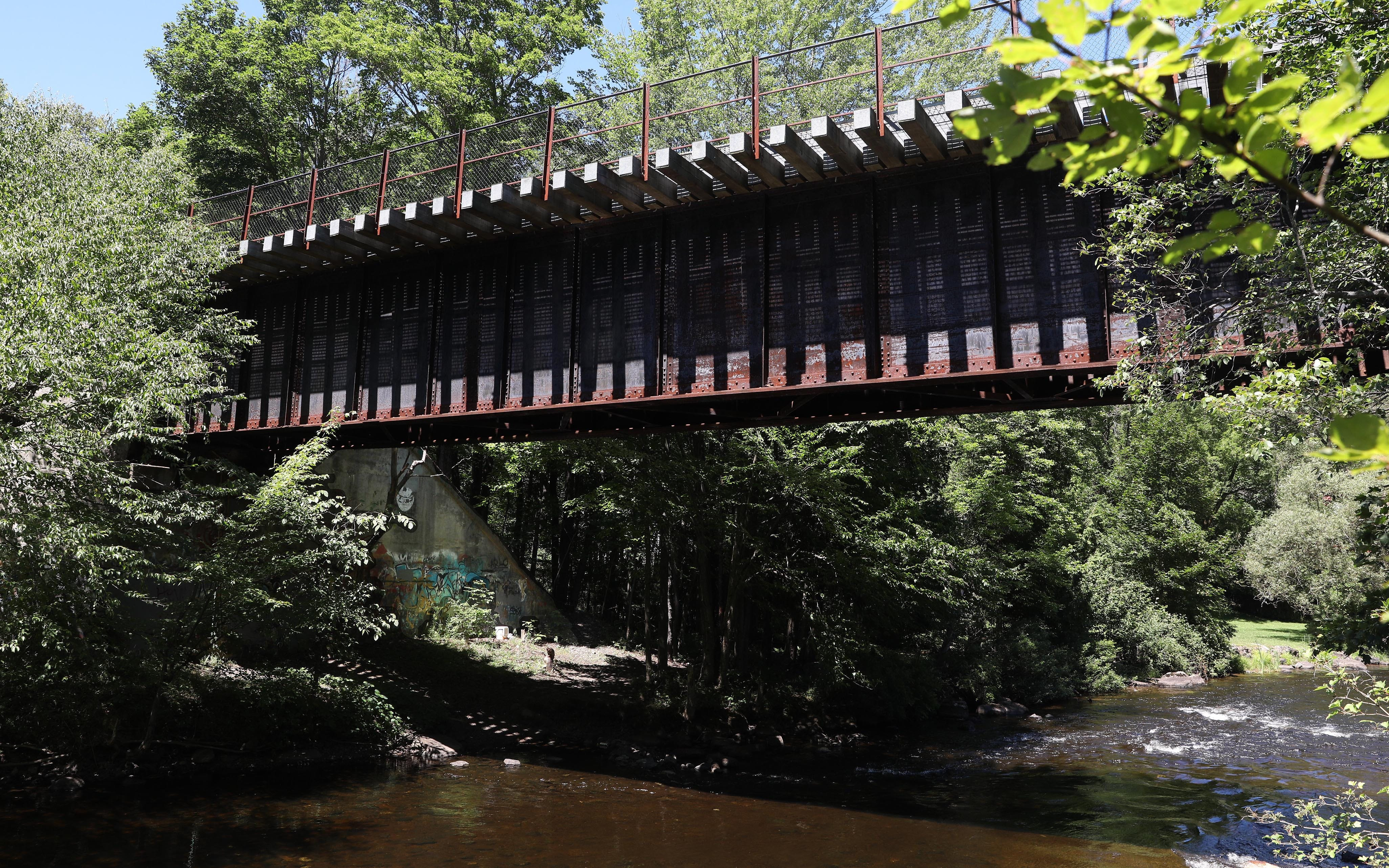 An old railroad trestle over the Saranac River in downtown Saranac Lake July 28, 2020.