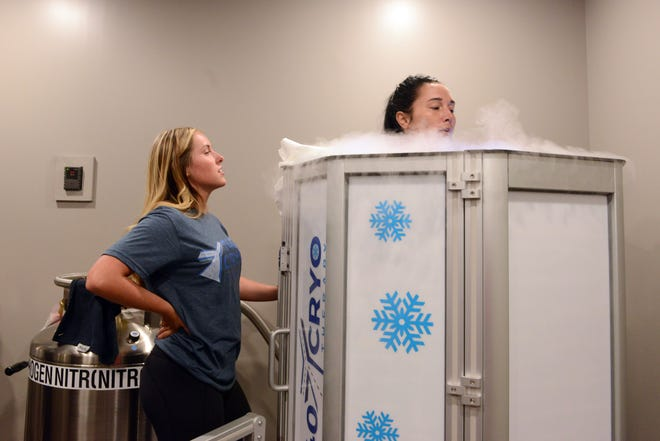 Sierra Brown, left, of 740YCryo, assists customer Desiree Tysinger during a cryotherapy session. The business, which opened July 27, is the first of its kind in Zanesville.