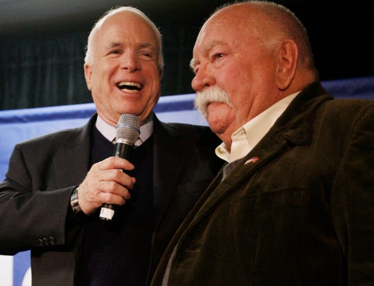 Republican presidential hopeful Sen. John McCain, R-Ariz., left, introduces Wilford Brimley at a Jan. 4, 2008, campaign stop at Hudson Veterans of Foreign Wars Post 5791 in Hudson, N.H.