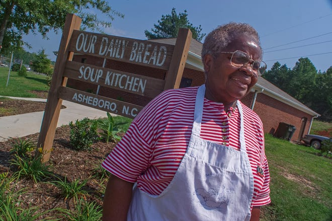 Dora Atlas poses outside Our Daily Bread Soup Kitchen in 1999. The soup kitchen is located at 831 E. Pritchard St., Asheboro.