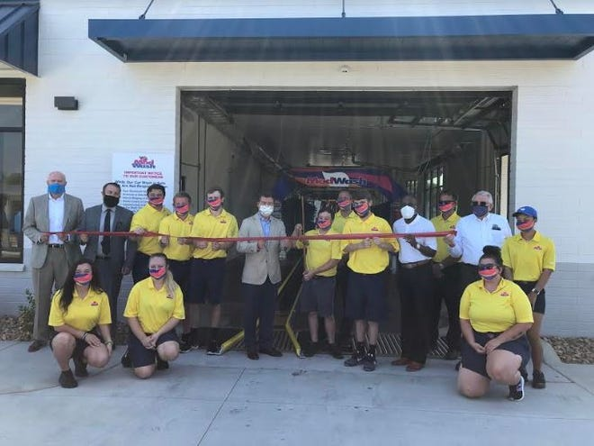 The Lexington Area Chamber of Commerce participated in a ribbon cutting ceremony on July 15 for ModWash, located at 150 Lowes Blvd. Pictured are: Standing, left to right, Lexington Chamber President Joe Wallace, Ryan Short, Hampton Conrad, Alex Costner, Michael Long, Mayor Newell Clark, Dylan Tollie, Adam Dronet, Donovan Delane, City Councilor Donald Holt, Hans Weger and Jamayka Daniels; kneeling, left to right, Riley Griffith, Morgan Janes O'Rourke and Sadie Owens.