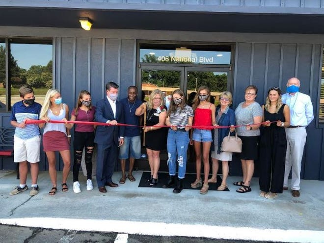 The Lexington Area Chamber of Commerce participated in a ribbon cutting ceremony on July 11 for Hardware and Roses, located at 406 National Blvd. Pictured, left to right, are Brady Lester Jr., Ashton Lester, Eleanor Clark, Mayor Newell Clark, City Councilor Donald Holt, Arianna Lester owner, Brianna Lester, Annika Lester, Ann Easter, Wendy Furr Marion, Tessa Hamilton and Lexington Chamber President Joe Wallace.