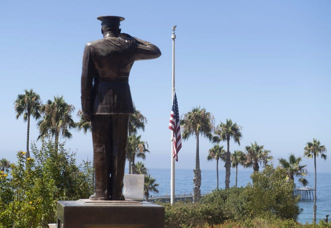 The U.S. flag was lowered to half-staff at Park Semper Fi in San Clemente, Calif., on Friday, July 31, 2020. Eight troops aboard a landing craft that sank off the Southern California coast during a training exercise are presumed dead, the Marine Corps announced Sunday, Aug. 2, 2020.