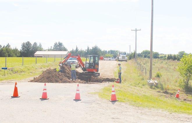 SC Telcom service workers install underground fiber for highspeed broadband internet access south of Pratt.
