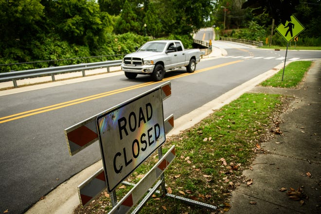 A road closed sign sits at the ready if Cool Spring Street floods when the tropical storm passes through Monday night.