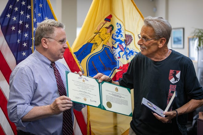 Vietnam War hero Bart Fabian (right) receives a Silver Star from Rep. Chris Smith