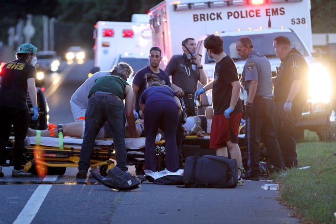First aiders from Brick and Point Pleasant Borough tend to two of the multiple injuries in a head-on crash on Herbertsville Road in Brick Township Sunday evening, August 2, 2020.