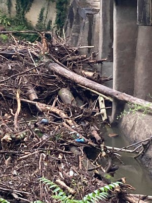 The city of Asheville is working to remove logs, branches and debris from around a bridge on the Swannanoa near the Benjamin Lewis Soccer Complex off Azalea Road in East Asheville.