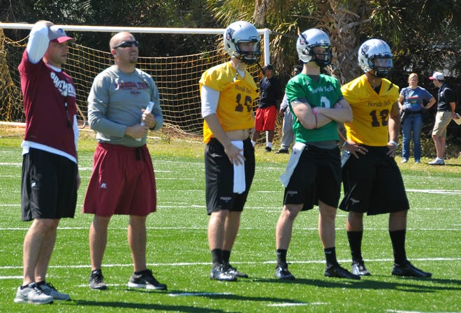 Jayson Martin (second from left) works with Florida Tech quarterbacks.