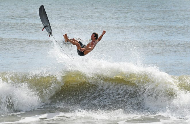 A surfer goes airborne Monday morning on a Tropical Storm Isaias-generated swell at Paradise Beach Park in near Indialantic.