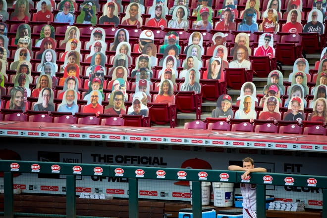 Cincinnati Reds starting pitcher Sonny Gray (54) looks out onto the field before a rain delay of the Cincinnati Reds and the Cleveland Indians at Great American Ball Park in Cincinnati on Monday, Aug. 3, 2020.