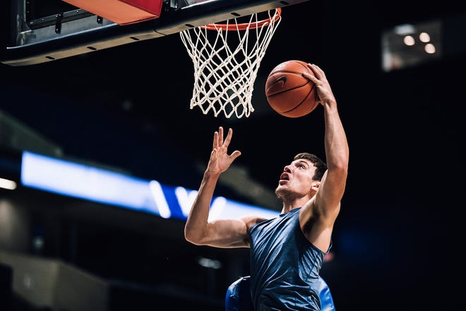 Xavier University sophomore Zach Freemantle goes up for a dunk during a summer practice on July 28, 2020. It was Xavier's first week of organized practice since the novel coronavirus pandemic hit in March.