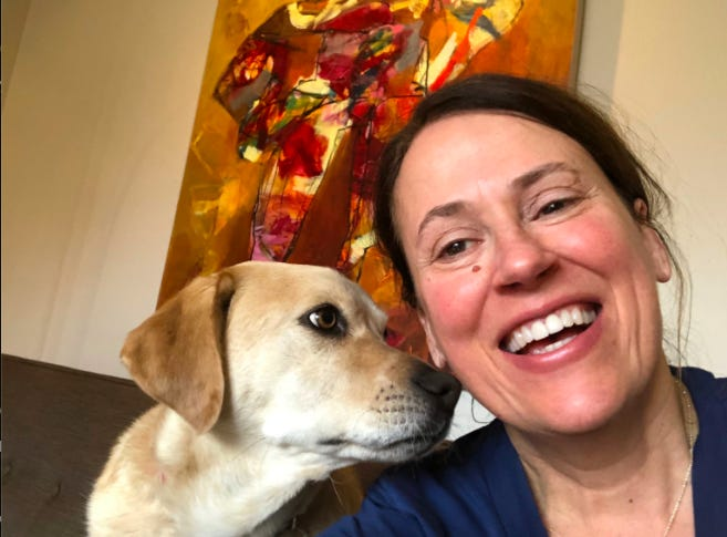 Democratic Senate candidate Theresa Greenfield poses for a selfie with her dog, Ringo.