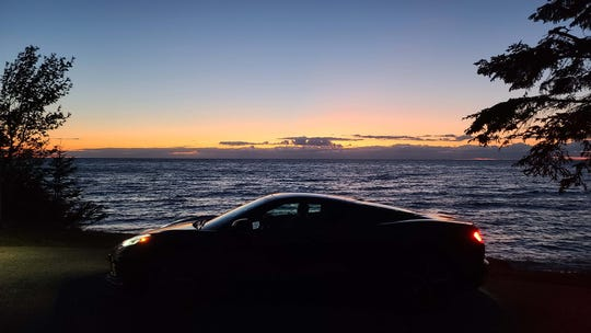The lovely profile of the 2020 Chevy Corvette at sunset in northern Michigan. The 'Vette has huge bandwidth as a track — and trip — car.