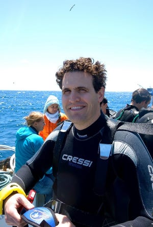 SCCF CEO Ryan Orgera on a no-chum Great White Shark dive in South Australia when he was advocating for shark conservation on a global level for The Pew Charitable Trusts.