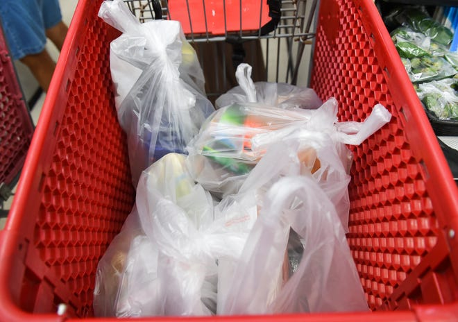 Bagged groceries are placed in a shopping cart at Super Happy Mart in Barrigada, Aug. 3, 2020.
