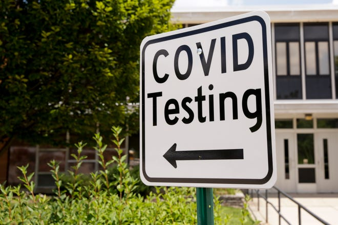 A COVID-19 Testing sign is posted outside Happy Hollow Elementary, Monday, Aug. 3, 2020 in West Lafayette.