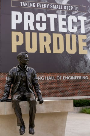 """Taking every small step to protect Purdue"" hangs on a banner outside of the Neil Armstrong Hall of Engineering on Purdue University's campus, Monday, Aug. 3, 2020 in West Lafayette."