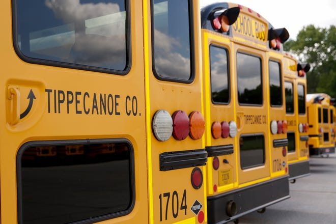 School buses sit parked in the Tippecanoe School Corp. lot, Monday, Aug. 3, 2020 in Lafayette.