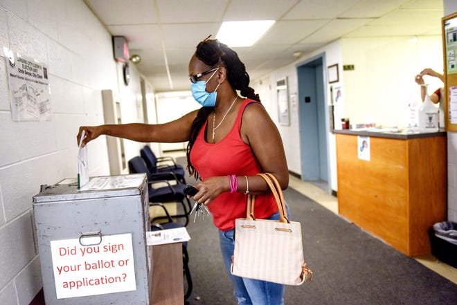 Monique Roddy drops off her ballot at the Lansing City Clerk's Election Unit on Monday, Aug. 3, 2020, in Lansing.